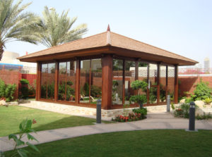 Shingle Roof gazebo in a garden